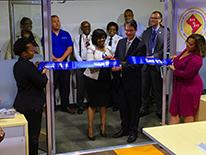 A group of people cutting the ribbon at the Call Simulation Lab